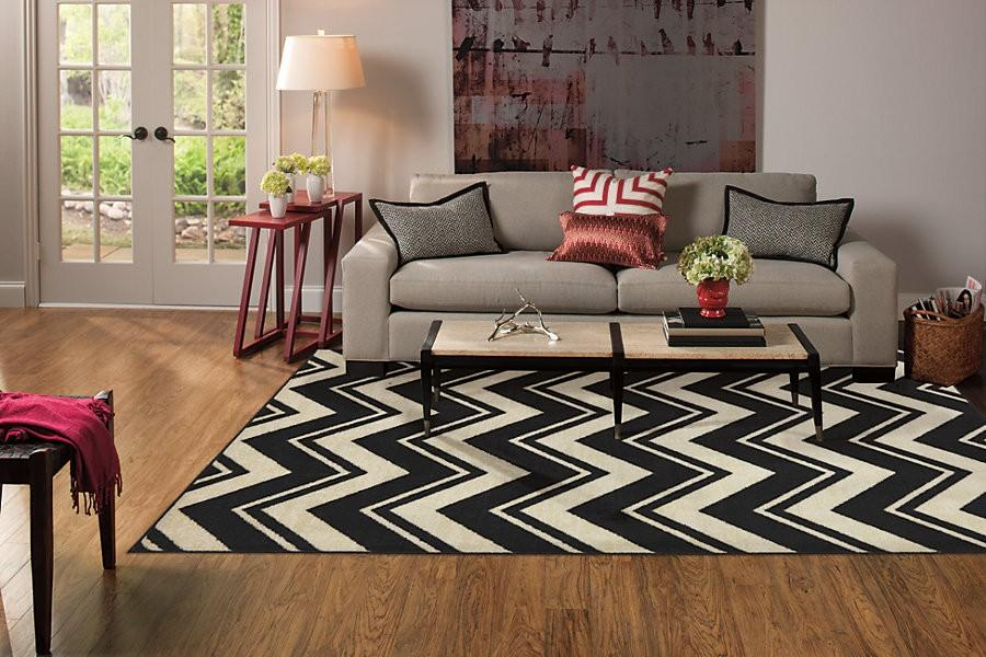Area rug to bring the room together, add comfort, character  and style